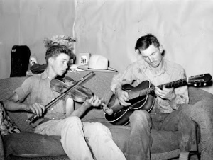 Farmer and his brother making music.